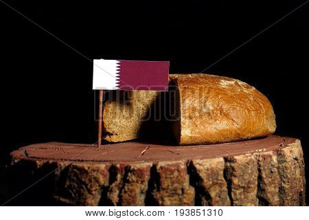 Qatari Flag On A Stump With Bread Isolated