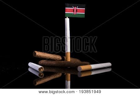 Kenyan Flag With Cigarettes And Cigars. Tobacco Industry Concept.