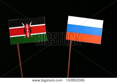 Kenyan Flag With Russian Flag Isolated On Black Background