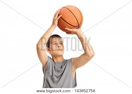 Boy throwing a basketball isolated on white background