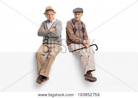 Angry seniors sitting on a panel isolated on white background