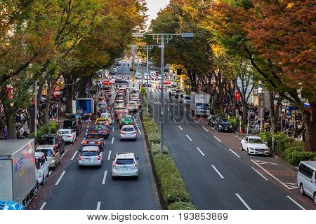 TOKYO, JAPAN - NOVEMBER 12, 2016: Cars in traffic on the street of Tokyo, Japan. Tokyo Metropolis is both the capital and most populous city of Japan.