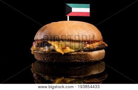 Kuwaiti Flag On Top Of Hamburger Isolated On Black Background