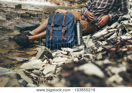 Unrecognizable Male Traveler Drink Tea Or Coffee From Thermos Hiking Leisure Resting Concept