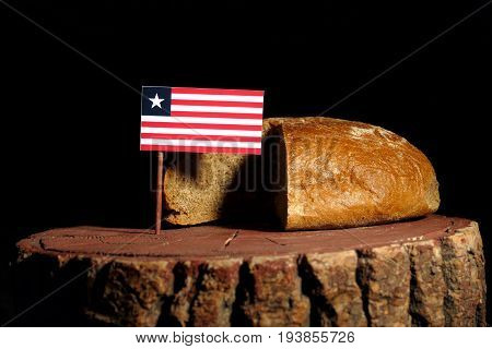 Liberian Flag On A Stump With Bread Isolated