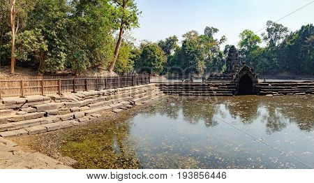 The central pond at Neak Pean with ancient Khmer architecture Angkor Complex, Siem Reap, Cambodia. Famous Cambodian landmark, World Heritage.