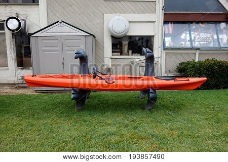 Angler kayak rigged and properly outfitted ready to leave its dry land stand