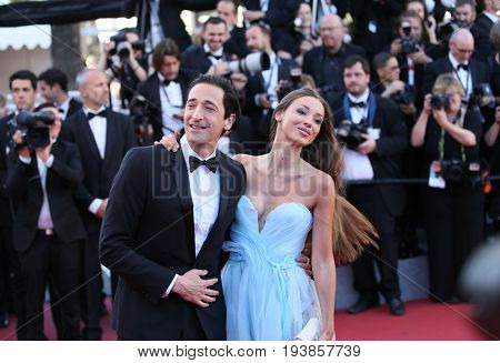 Adrien Brody and Lara Lieto attend the 'Ismael's Ghosts (Les Fantomes d'Ismael)' & Opening Gala Red Carpet Arrivals during the 70th annual Cannes Film Festival at on May 17, 2017 in Cannes, France.