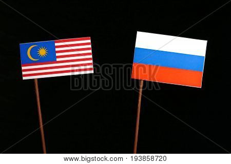 Malaysian Flag With Russian Flag Isolated On Black Background