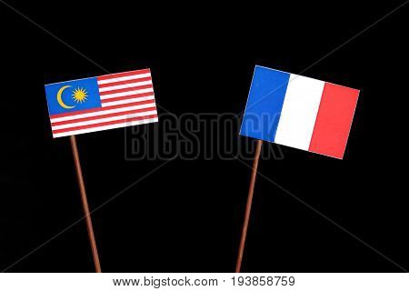 Malaysian Flag With French Flag Isolated On Black Background