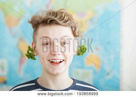 Happy Boy With Parsley In Ears