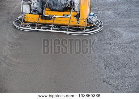 Concrete floor grinding machine working on the fiber reinforced surface