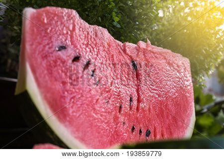 Watermelon slice close up with summer sun hue
