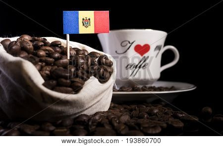 Moldovan Flag In A Bag With Coffee Beans Isolated On Black Background