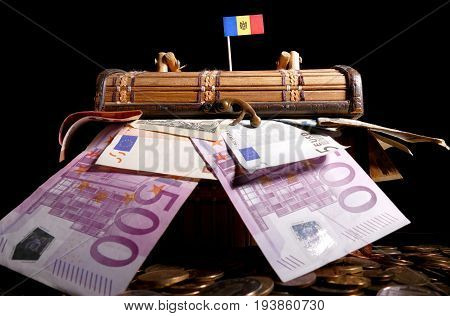 Moldovan Flag On Top Of Crate Full Of Money