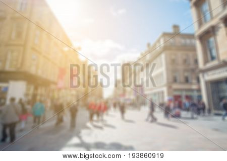 Blurred Image Of People Walking On The Street, With Car, Building In Background. Buchanan Street In