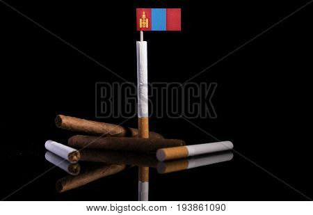 Mongolian Flag With Cigarettes And Cigars. Tobacco Industry Concept.