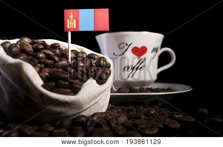 Mongolian Flag In A Bag With Coffee Beans Isolated On Black Background