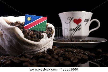 Namibian Flag In A Bag With Coffee Beans Isolated On Black Background