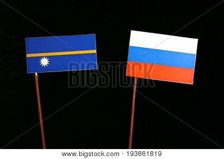 Nauru Flag With Russian Flag Isolated On Black Background