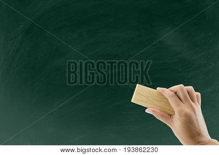 Hand With Eraser Erases The Chalkboard, Hand With Blackboard Eraser Cleaning Blackboard
