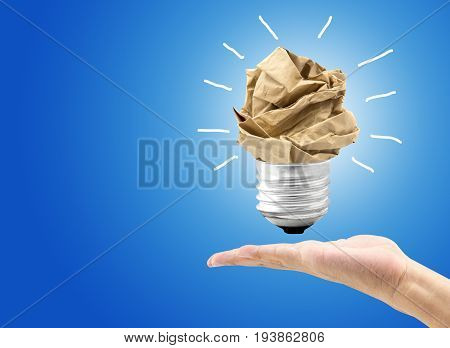 great idea concept with crumpled colorful paper and light bulb hold hand on light background. Creative concept business idea innovation and solution creative design.