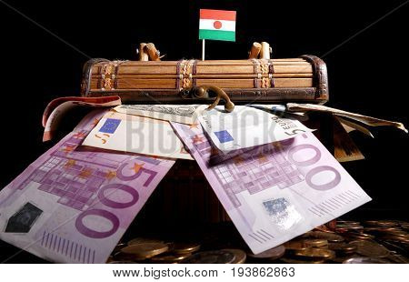 Niger Flag On Top Of Crate Full Of Money