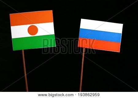Niger Flag With Russian Flag Isolated On Black Background