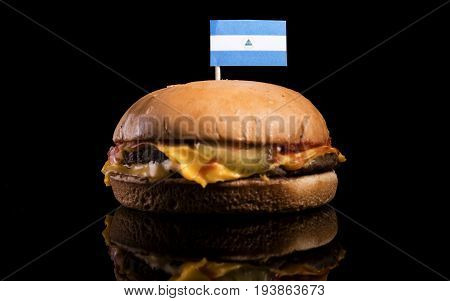 Nicaraguan Flag On Top Of Hamburger Isolated On Black Background