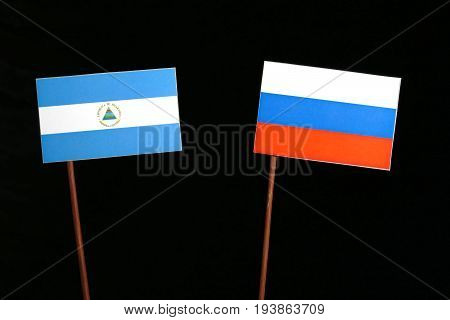 Nicaraguan Flag With Russian Flag Isolated On Black Background