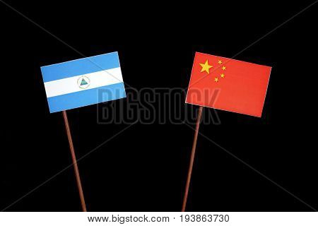 Nicaraguan Flag With Chinese Flag Isolated On Black Background