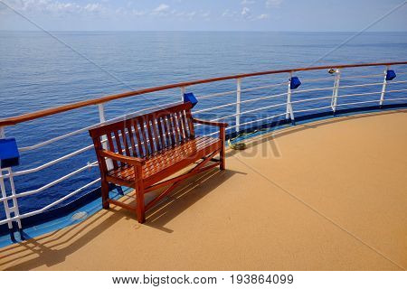 Empty bench on deck of cruise ship