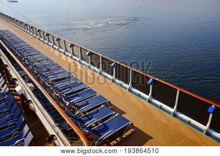 Lounge chair on deck of cruise ship