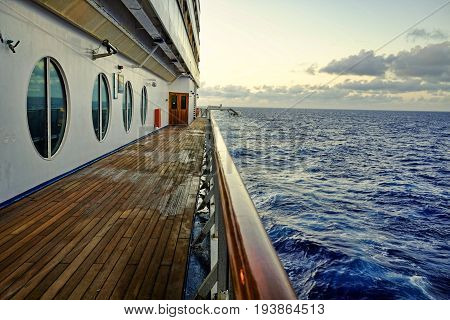 Empty wooden Cruise Ship Deck at Dusk