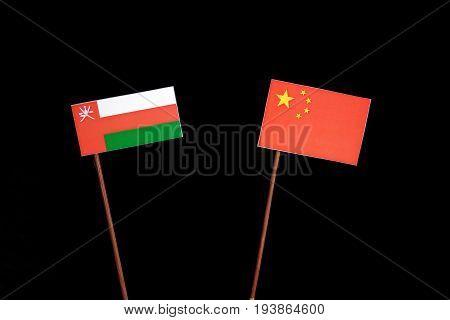 Omani Flag With Chinese Flag Isolated On Black Background