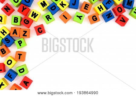 Corner Border Of Colorful Toy Alphabet Letters Over A White Background