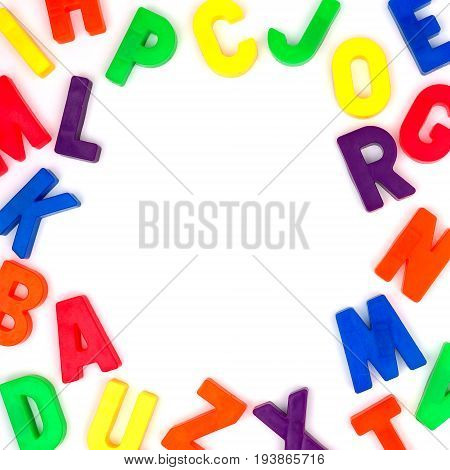 Square Frame Of Colorful Toy Magnetic Alphabet Letters Over A White Background