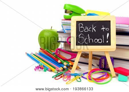 Back To School On Chalkboard With Books And School Supplies Isolated On A White Background