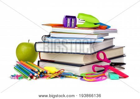 Stack Of Books And School Supplies Isolated On A White Background