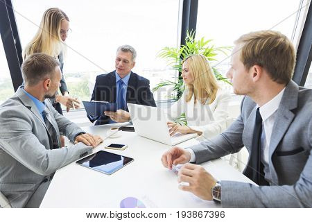 Business people team at meeting working with papers