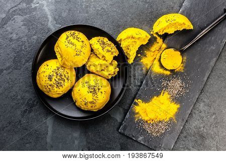 Bread Burger Buns With Superfoods Curcuma And Chia On Slate Background. Top View