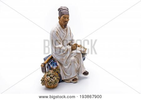 Chinese Old Man Sit and Thoughtful Statue Isolated on White Background