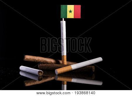 Senegal Flag With Cigarettes And Cigars. Tobacco Industry Concept.