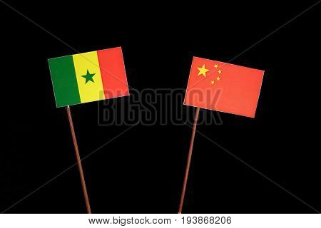 Senegal Flag With Chinese Flag Isolated On Black Background