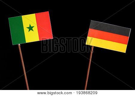 Senegal Flag With German Flag Isolated On Black Background