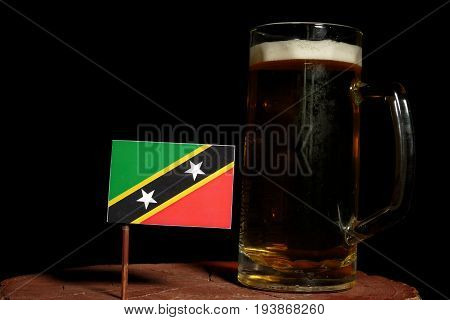 Saint Kitts And Nevis Flag With Beer Mug Isolated On Black Background