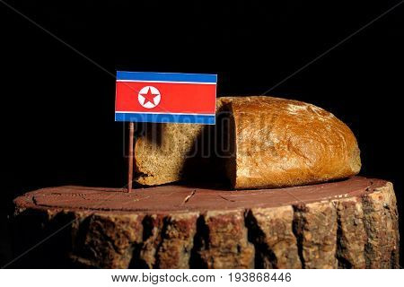North Korean Flag On A Stump With Bread Isolated