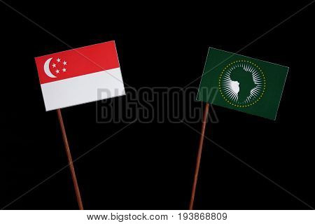 Singaporean Flag With African Union Flag Isolated On Black Background