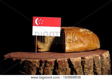Singaporean Flag On A Stump With Bread Isolated