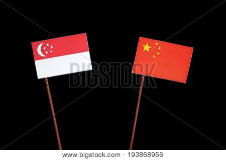 Singaporean Flag With Chinese Flag Isolated On Black Background